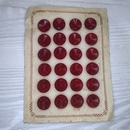 Card with 24 x 13mm vintage Red buttons