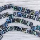 25 x Tila beads in Matt Black with Shell design