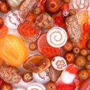 25g of pressed and faceted beads in Orange