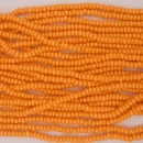 1 string of Size 11 Orange Lustre Czech charlottes
