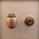 COB-03-A Brown Stripes, Orange and White Triangles oval bead