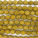 8mm string of snake skin beads in Dark Yellow
