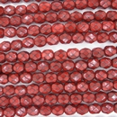25 x 6mm snake skin beads in Dark Coral