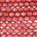 15 x 10mm snake skin beads in Dark Coral