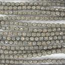 38 x 4mm snake skin beads in Sand