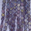 12 x table cut beads in Amethyst with laser etched shell (9x8mm)