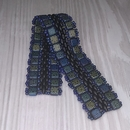 Selection of Black, Blue and Laser Etched beads for the bracelet Fantastic Frills